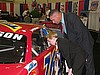 Father and Son checks out race car